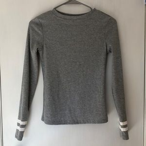Gray shirt with stripes on sleeves